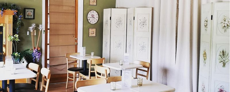 Indoor cafe space of the Cozy Tea Cart
