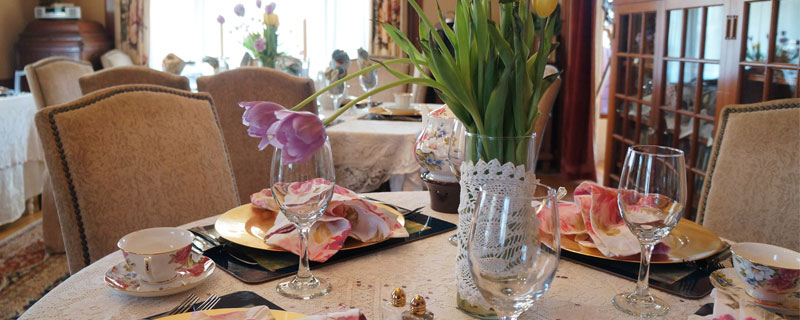 Elegantly set table with spring flowers and tea cups